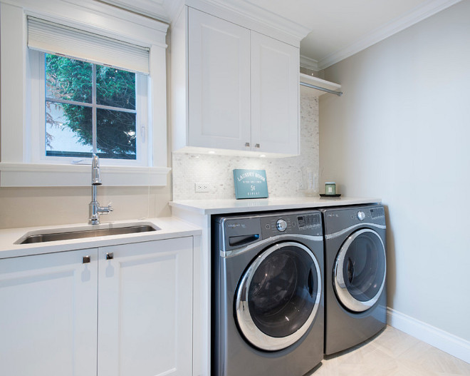 Laundry Room. Laundry Room. White laundry room cabinets with gray washer and dryer. Wall paint color is Collingwood OC-28 Collingwood Eggshell Benjamin Moore. #Laundryroom Kemp Construction. Sarah Gallop Design Inc.