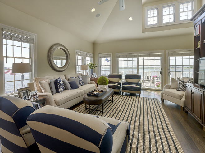 Living room with striped fabric and rug. Megan Gorelick Interiors