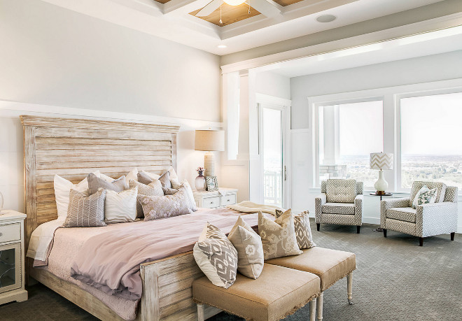 Master Bedroom. Bedroom. Bedroom features coffered ceiling, gray carpet, patterned armchairs, seating area, tray ceiling, white trim, whitewashed wooden bed and wood ceiling. #Bedroom #Masterbedroom DWL Photography