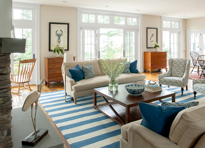 Neutral living room with blue and white decor. Banks Design Associates