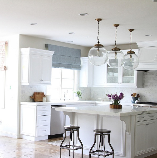 One of my favorite elements of the kitchen are the glass, globe, pendant lights. I love the mix of the metals in the kitchen from the antique brass on the lights. #Kitchenpendants #Globependants
