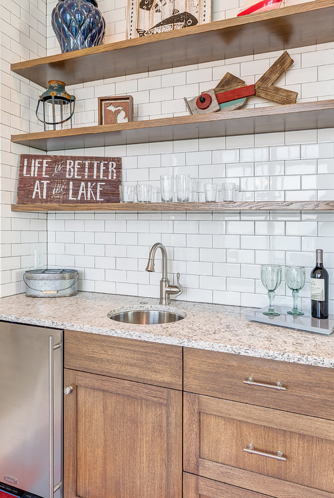 Rustic Butlers pantry with floating shelves and subway tile backsplash. Mike Schaap Builders