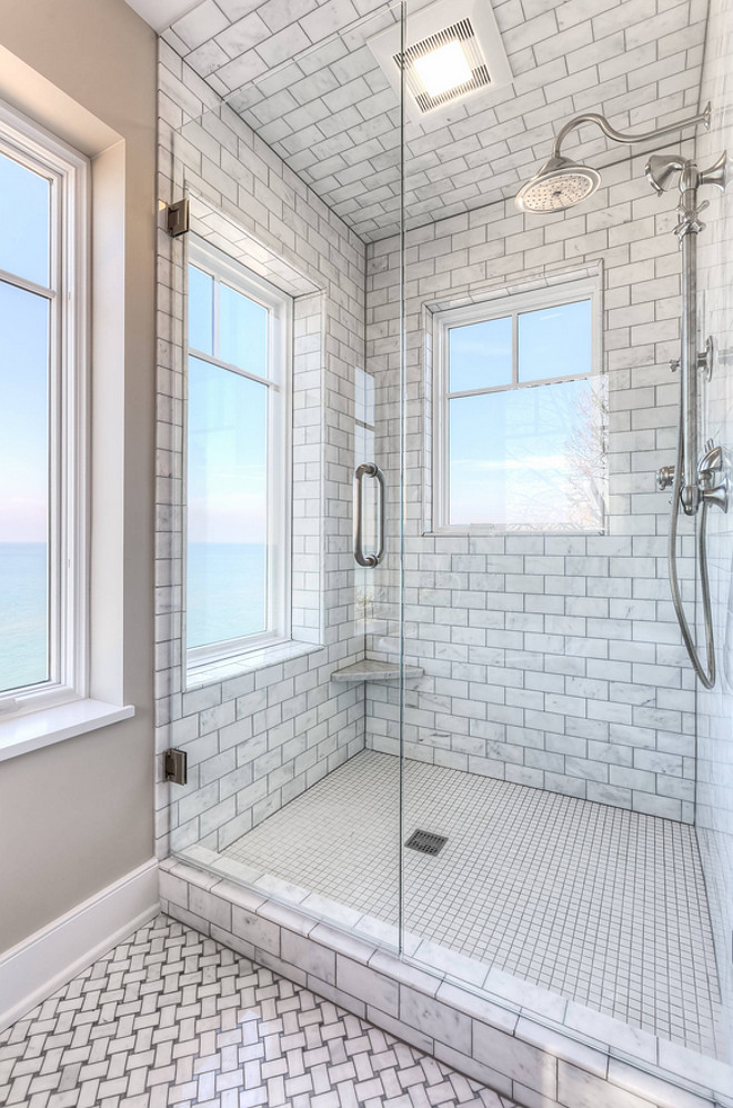 Shower tiling. Floor to ceiling shower tile. The shower features floor-to-ceiling Carrara marble tile. Shower with floor to ceiling tiles. Shower with floor to ceiling tiling. Shower with floor to ceiling subway tile. Mike Schaap Builders