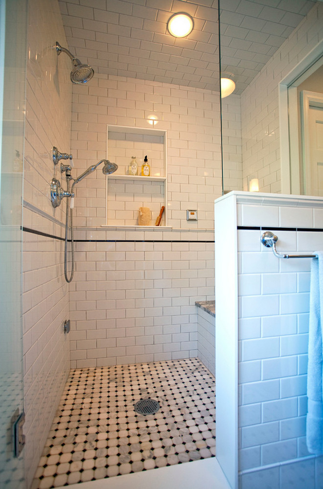 Shower. Bathroom Shower. Shower has a built-in bench, niche, and secondary hand-held shower. #Shower #ShowerBench #ShowerNiche #showerideas #ShowerReno  TreHus Architects+Interior Designers+Builders