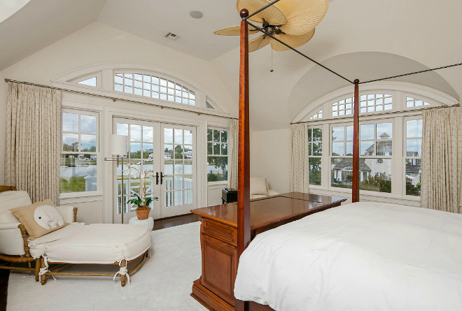 Traditional Bedroom with arched window transoms. Christie's Real Estate