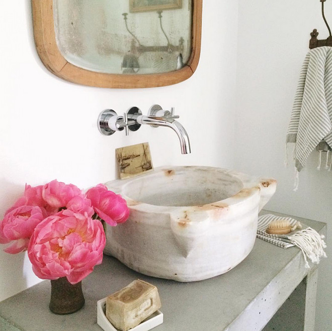 Marble basin with wall mounted bathroom faucet. Heather Bullard.