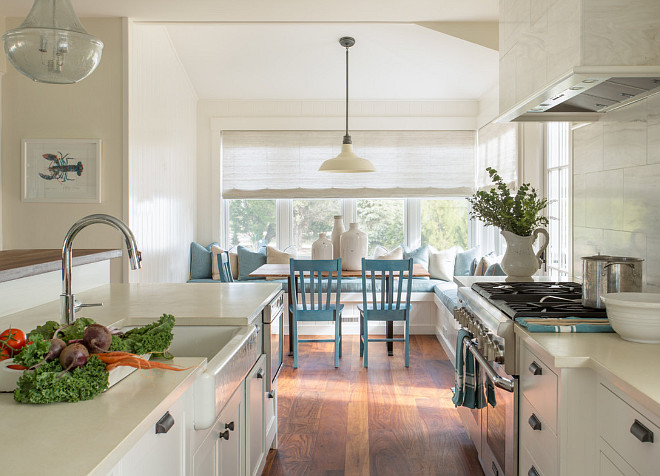 Creamy white kitchen. Creamy white kitchen features neutral off white wall paint color, hardwood floors and creamy white countertops. #Creamywhitekitchen #Offwhitekitchen #whitekitchen #NeutralKitchen Martha's Vineyard Interior Design