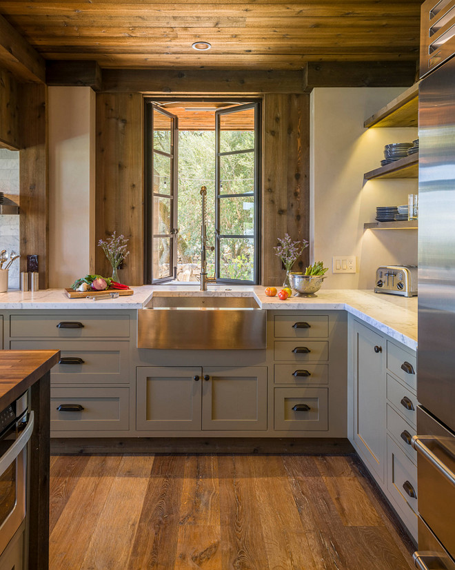 Rustic Kitchen. Rustic Kitchen with Gray cabinet painted in Benjamin Moore Gettysburg Grey HC 107 . The door style is Inset. The wide plank floors are European Oak that is wired brushed. The company is Provenza, Pompeii collection and the color is Amiata. The kitchen faucet is Kraus, model KPF-1602. The window manufacturer is Bloomberg. The stainless steel farmhouse sink is Krauss, model KHF200-30. The counter is carrara marble. This rustic kitchen features reclaimed wood on ceiling and as wall accent. The wood is cedar that's been treated to look distressed. #RusticKitchen #Reclaimedwood #RusticKitchenWood #RusticKitchenColoe #RusticKitchenPaintcolor #RusticKitchenSink #RusticKitchenFaucet #RusticKitchenFlooring Barbra Bright Design