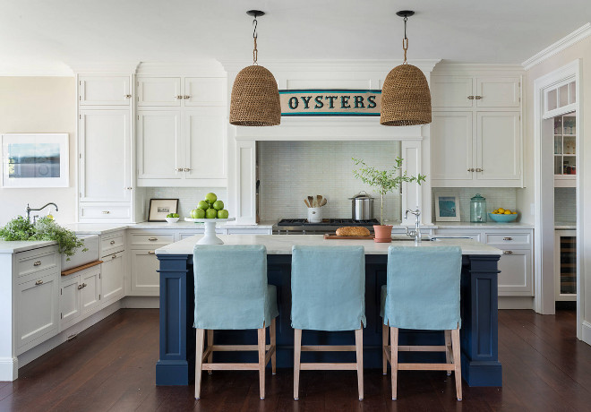 A #coastal kitchen turns #nautical with woven #pendants by Jeffrey Alan Marks and #serenaandlily #stools in turquoise linen. a #kitchenPeninsula features apron sink. #beachhouse #design #interiors #interiordesign Kate Jackson Design