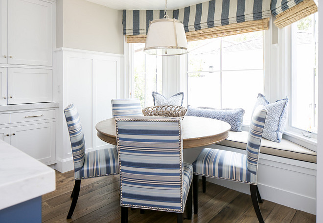 Breakfast Nook Windows. Breakfast nook windows feature striped roman valances with woven shades underneath. #BreakfastNook #BreakfastNookWindows #BreakfastNookRomanshades #BreakfastNookShades #BreakfastNookWovenShades #Wovenshades #Romanshades #windowshades