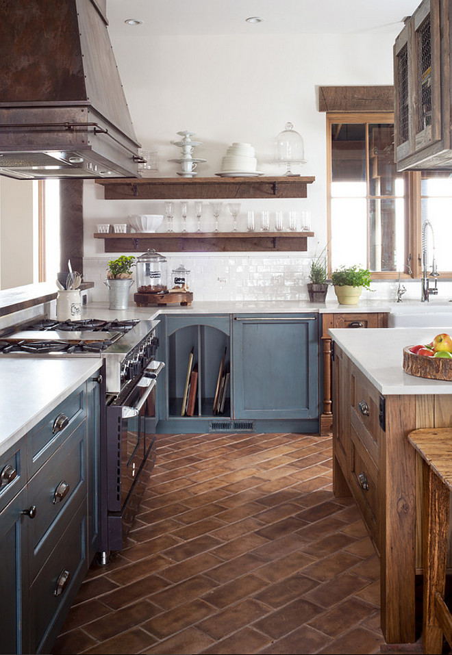"Rustic kitchen flooring. Rustic kitchen flooring. Rustic kitchen flooring. Rustic kitchen. Rustic kitchen flooring is a tile made of concrete. It is 3/4"" thick, so the floor framing was set lower to create a smooth transition to the adjoining wood floor. It is not slippery. The manufacturer is ""Arto"". #Kitchenflooring #kitchenfloor #kitchentiles #rustickitchen #rustickitchenflooring  Dragonfly Designs"