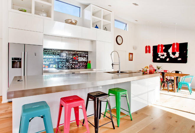Tolix counterstool. Tolix counterstool. White kitchen with colorful Tolix counterstools and chairs. Tolix counterstools. Tolix counterstool #Tolixcounterstool Lucy G Creative NZ Photography & Splashbacks