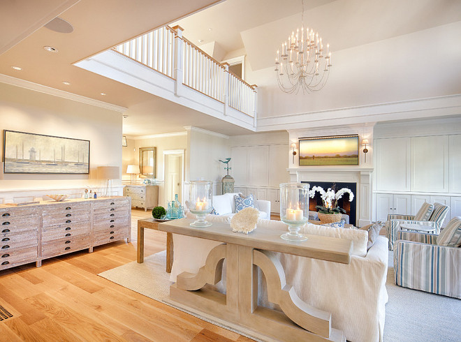 Living room Furniture and Decor Ideas. Living room features great furniture layout and decor ideas. Living room Furniture and Decor. #Livingroom #LivingroomFurniture #LivingroomFurnitureLayout #LivingroomDecor #LivingroomDecorIdeas The stunning chandelier is Thomas O'Brien Erika Three-Tier Chandelier in Belgian White
