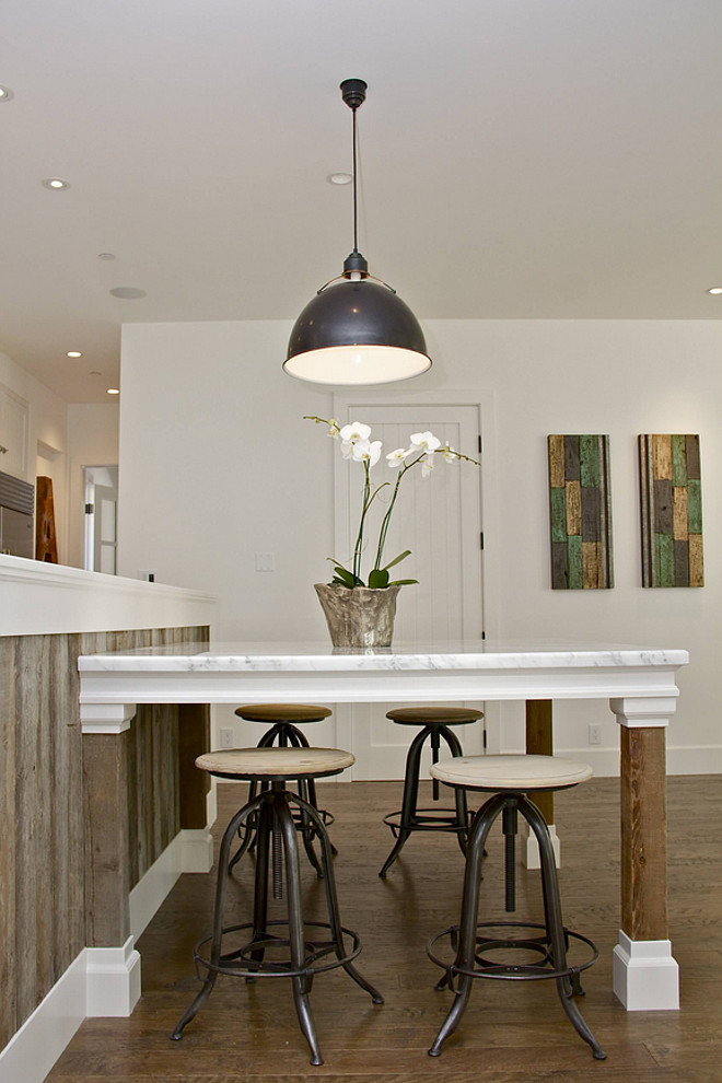 Kitchen island table . Custom marble top and reclaimed wood kitchen table supported off the island. Kitchen island table ideas. Kitchen island table #Kitchenislandtable #Islandtable #kitchenislandwithtable KCS, Inc