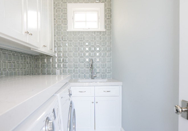 Small Laundry Room. A geometric backsplash tile and white quartz countertop adds interest to this small laundry room. #SmallLaundryroom #Laundryroom #Smallspaces #smallinteriors
