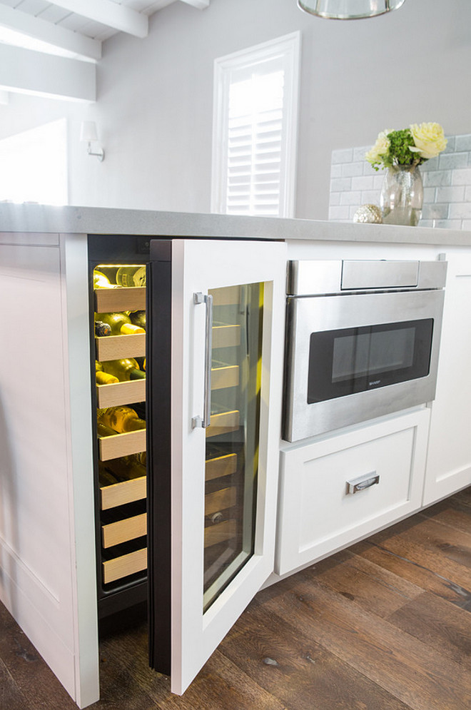 "Kitchen Peninsula. Kitchen peninsula dimensions. The base cabinet width is actually 84"" ( 18"" wine ref, 24"" mic drawer, and 42"" pull out corner cabinet. The counter depth is 52 "" and counter width is 96"" due to a 12"" overhang on both sides. Dannielle Albrecht Designs"