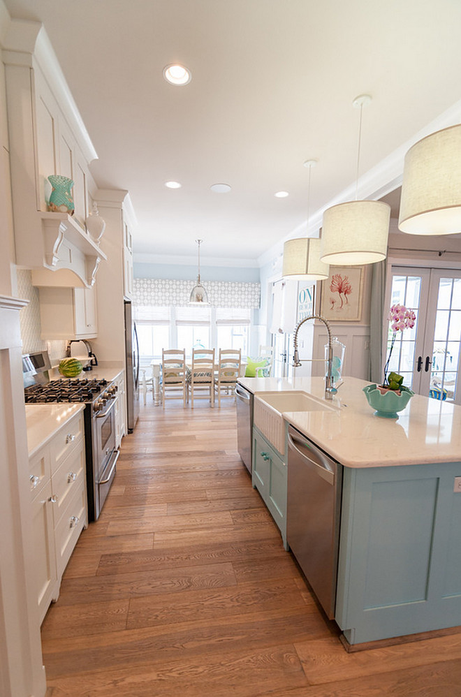 White kitchen with blue island paint color. Kitchen pendants are Jamie Young Custom Drum Pendant Lights. White perimeter kitchen with blue island paint color. Blue island paint color is Sherwin Williams Quench Blue. #Whitekitchen #Blueisland #WhitekitchenBlueisland #Paintcolor #SherwinWilliamsQuenchBlue