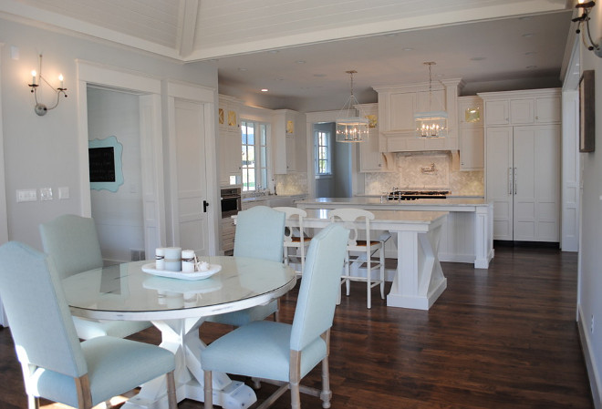 Kitchen features double islands. Wall sconces are by Low Country. Pendants over island are Urban Electric. Hardwood floors are hickory, wall color is Ben Moore HC Wickham Gray. Table is custom by Stacye Love Designs. #Kitchen #DoubleIsland #DoubleIslandkitchen