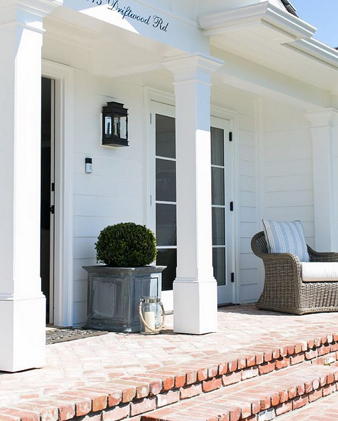 Brick Porch. White home exterior with brick porch. Vintage brick porch. #brick #Porch #brichporch #porchideas Brooke Wagner Design