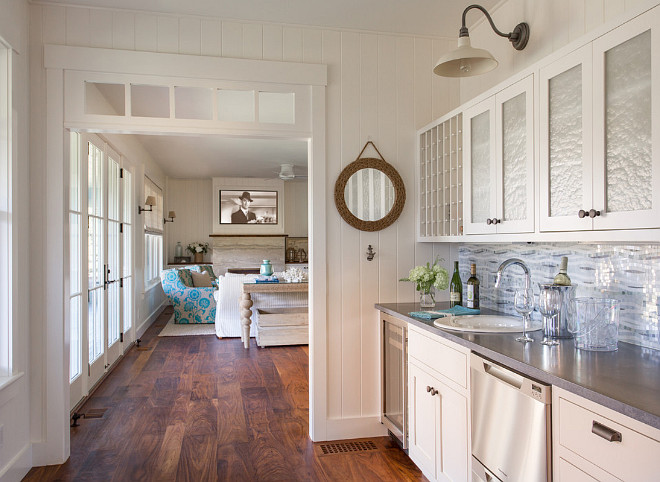 Butlers pantry features wide plank hardwood floors and vertical wall paneling. #butlerspantry #wideplankfloors #verticalpaneling #wallpaneling Martha's Vineyard Interior Design
