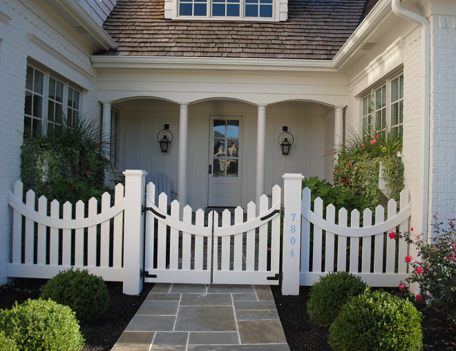 Courtyard with white picket fence and Bluestone patio tiles. #Courtywar #picketfence #whitepicketfence #Bluestone Stacye Love Construction & Design, LLC