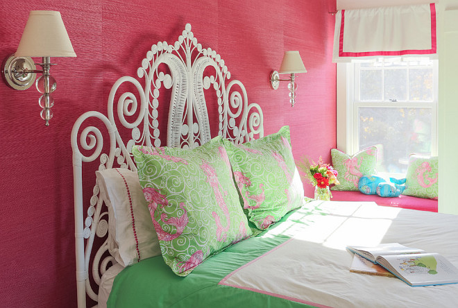 Girls Bedroom with pink grasscloth wallpaper and sconces above bed. A window seat is tucked across the bed. #kidsbedroom #girlsbedroom Martha's Vineyard Interior Design