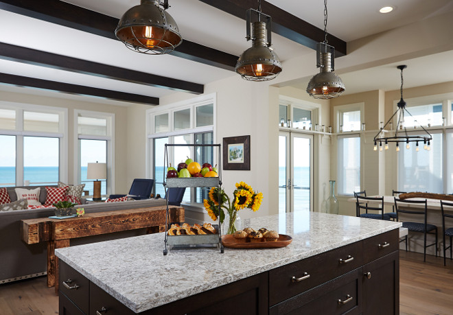Kitchen island. Kitchen island stone counter is New Wuay Cambria Quartz and dropped island table is pine stained with a slight distressing finish. Mike Schaap Builders