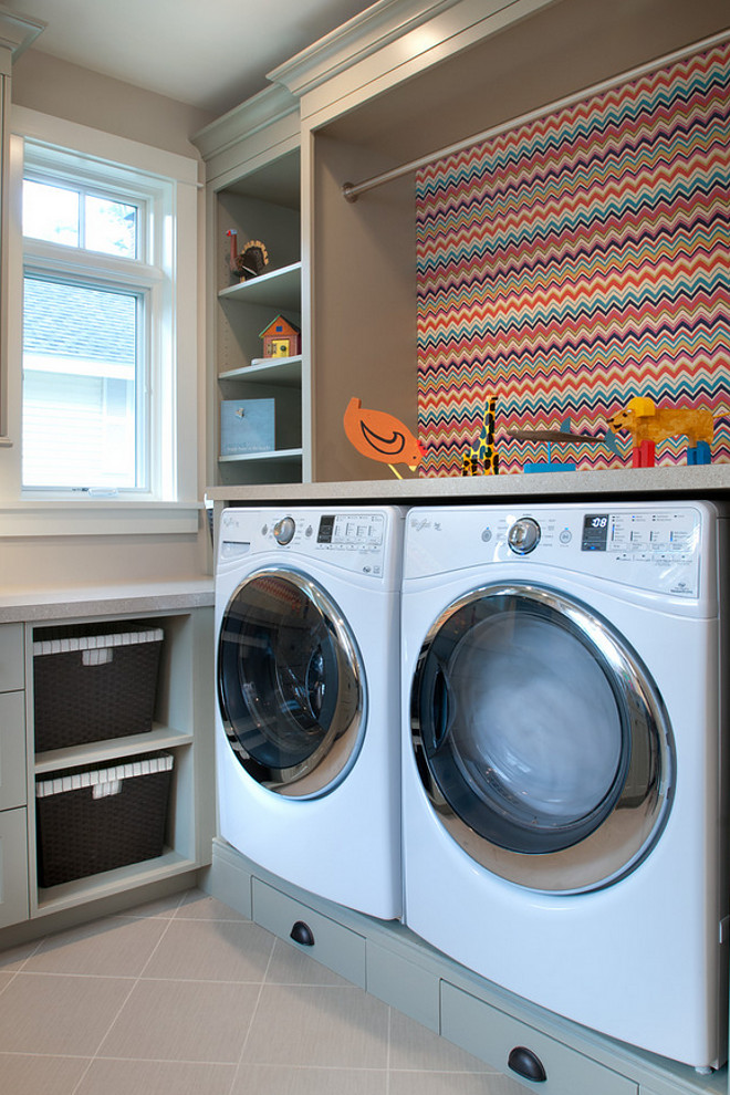 Laundry Room. Laundry Room Ideas. Laundry Room features gray cabinets and a colorful chevron wallpaper behind washer and drawer. #laundryroom #wallpaper #chevronwallpaper.