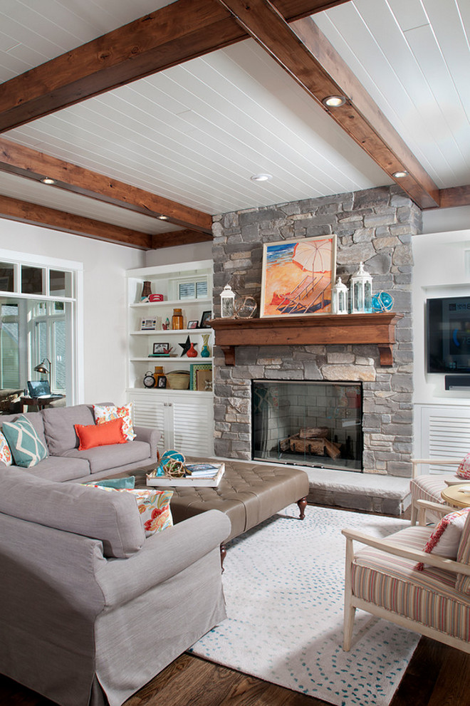 Living room fireplace. Coastal living room with stone fireplace. Stone fireplace in living room. #Livingroom #Stonefireplace #CoastalLivingroom #StonefireplaceLivingroom