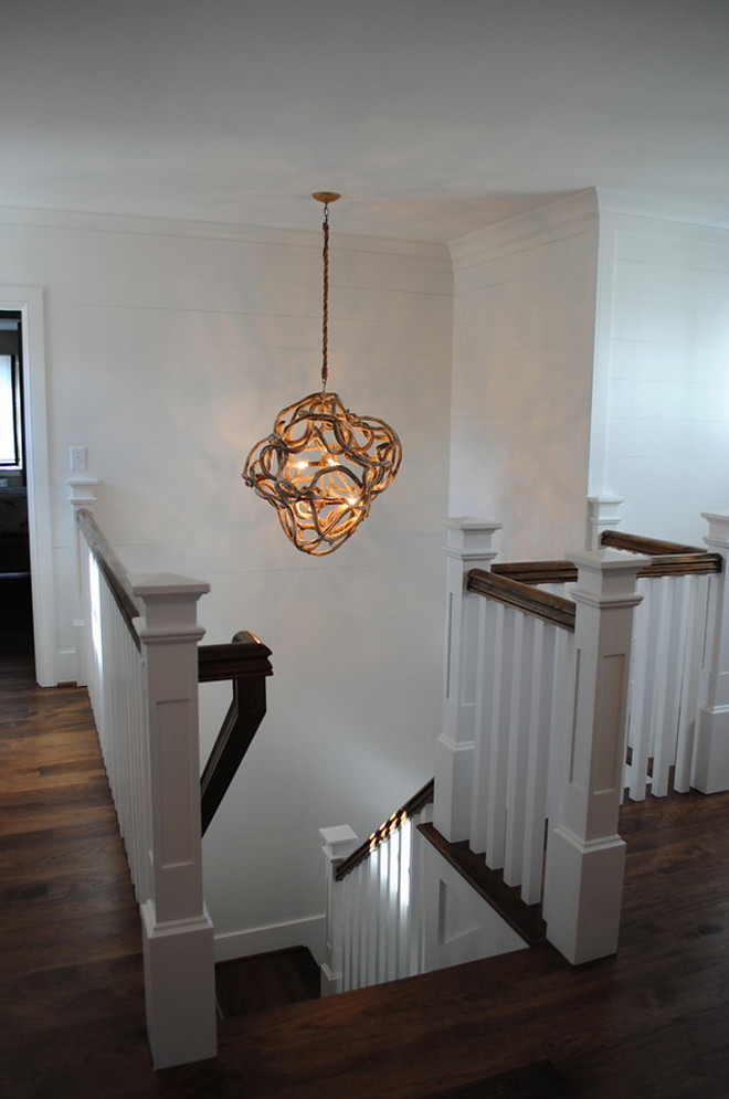 Stairway Lighting. Staircase features hallway wrapped in 1 x 10. Light fixture, driftwood by Low Country. Stacye Love Construction & Design, LLC