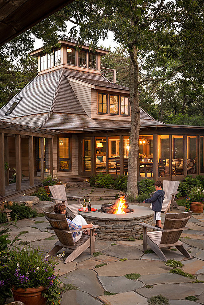 Stone firepit. Woodsy backyard with Stone firepit and stone patio. Stone firepit. Stone firepit ideas #Stonefirepit #Backyard Sullivan + Associates Architects