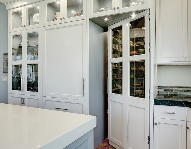 Kitchen pantry cabinet. Concealed pantry door and cabinetry with seedy antique glass inserts. Kitchen pantry cabinet. Kitchen pantry. #Kitchenpantry #Kitchenpantrycabinet #Kitchencabinet Kitchen #pantry Benchmark Design Studio