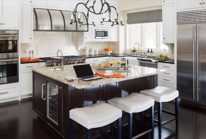 White kitchen with walnut stained kitchen and walnut stained flooring. Walnut island. White kitchen cabinets with walnut island. #Whitekitchen #walnutisland #walnutflooring Martha O'Hara Interiors