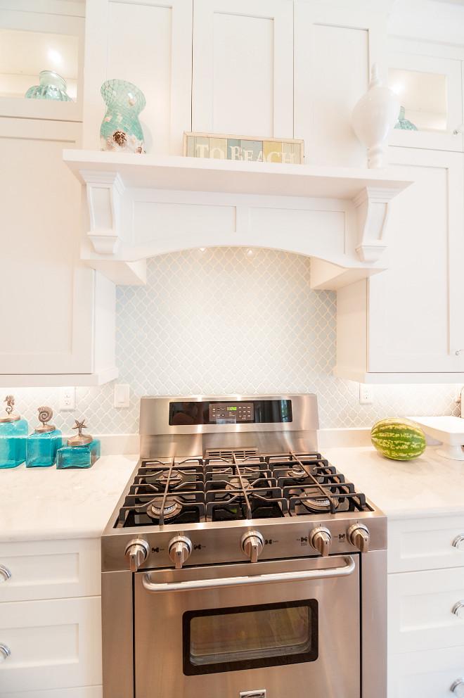 Mini Arabesque Tile. Kitchen features white cabinets with blue Mini Arabesque Tile. Mini Arabesque Tile. Mini Arabesque Tile Backsplash #MiniArabesqueTile #BlueMiniArabesqueTile #Kitchenbacksplashtile Strickland Homes
