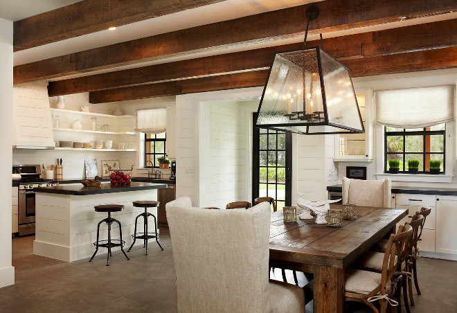 Rustic kitchen with tongue and groove cabinets and tongue and groove walls. Kitchen ceiling features reclaimed wood beams. #kitchen #rustickitchen #tongueandgroove #shiplap #kitchentongueandgroove #cabinets #walls #reclaimedceiling Giana Allen Design LLC.