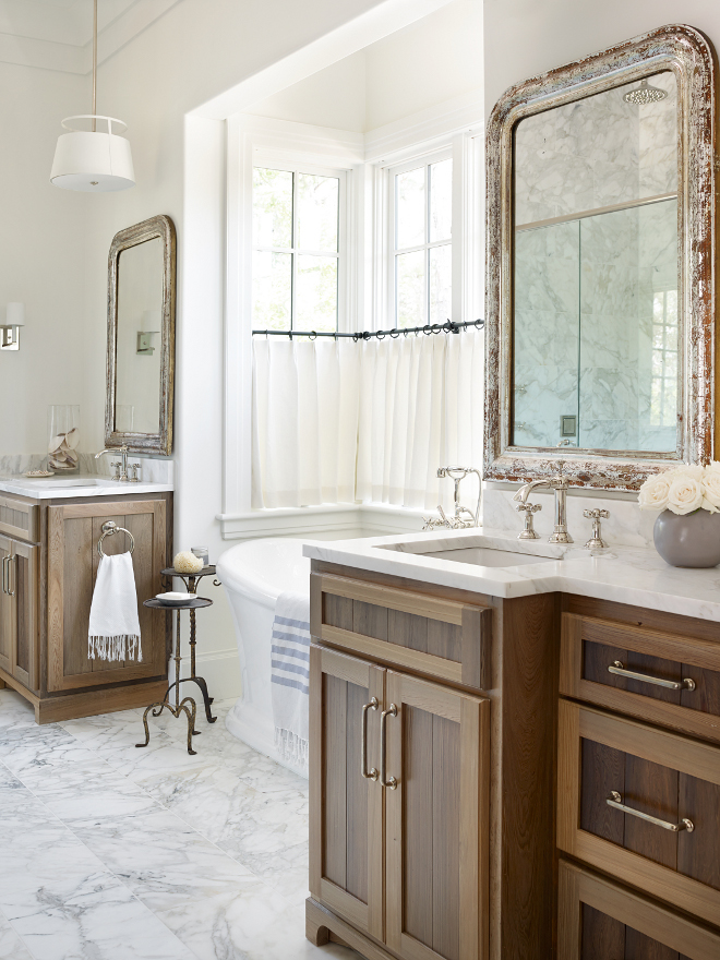 Rustic Bathroom Cabinet. This bathroom is a mix of elegance with rustic elements that keeps this space balanced. Cabinetry is reclaimed Cypress. Marble countertop is Calcutta Gold. Hardware is by Rocky Mountain Hardware. Rustic bathroom cabinet ideas. #RusticBathroom #RusticBathroomwoodCabinet #Rusticbathroomcabinet #Rusticbathroomcabinetideas #RusticBathroomwoodCabinetry Interiors by Courtney Dickey of TS Adams Studio