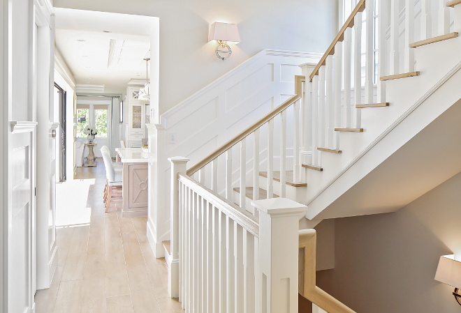 Staircase millwork and flooring. I love the light color wood floor (white oak) with the white staircase millwork. #lightwoodfloor Patterson Custom Homes. Interiors by Trish Steele, Churchill Design.