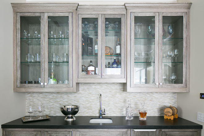 Wet Bar. Wet Bar Butlers pantry cabinet. The wet bar features reclaimed white oak cabinets and honed black granite countertop. #wetbar #bar #reclaimedwoodcabinet #whitewashcabinet #whiteoak #honedblackgranite Patterson Custom Homes. Brandon Architects, Inc.