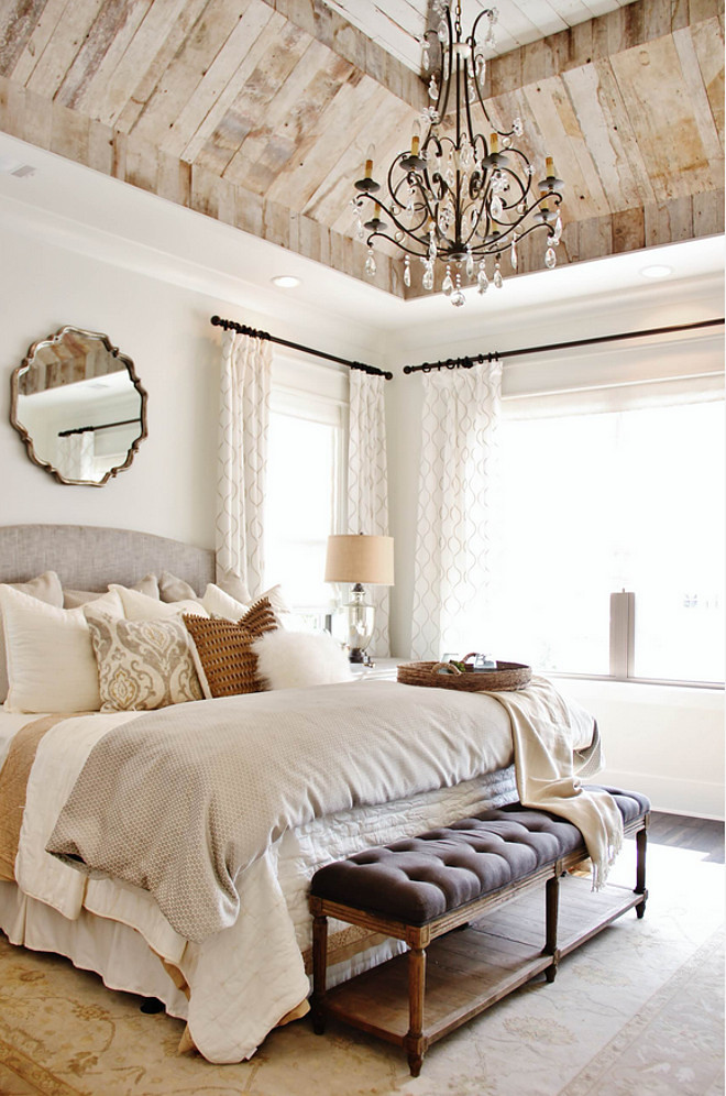 Reclaimed wood ceiling in bedroom. Wall paint color is Greek Villa from Sherwin Williams. Bedroom reclaimed wood on ceiling is reclaimed barnwood. Bedroom reclaimed wood ceiling. #GreekVillaSherwinWilliams #Bedroom #reclaimedwoodceiling #reclaimedbarnwood Landmark Homes of Tennessee