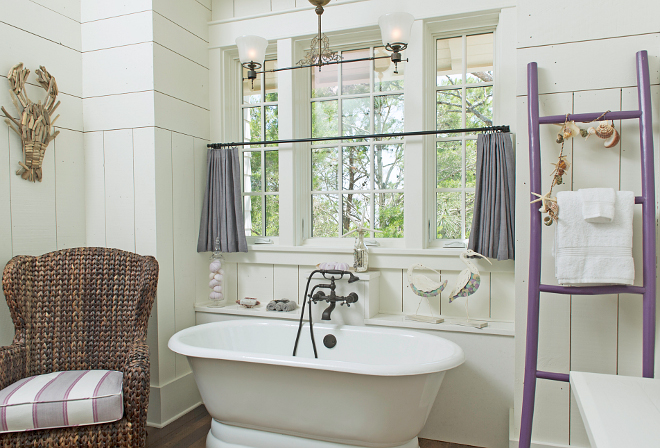 Bathroom. Isn't this a great bathroom? I love the purple ladder! Tub- Cheviot Faucet and tub filler- Cifial Chair – Pier 1 with custom cushion Ladder – Serena and Lily Light – Custom – Eloise Pickard #bathroom Interiors by Courtney Dickey and T.S. Adams Studio.