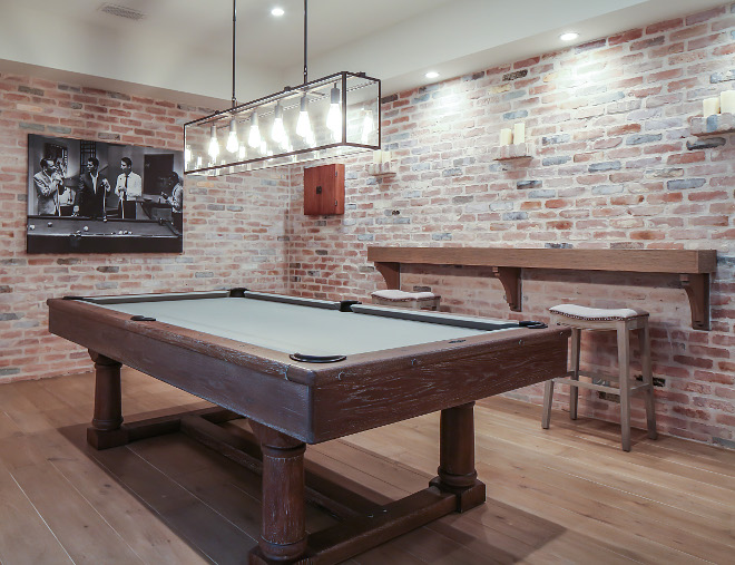 Games room. Exposed brick walls bring a rustic feel to this games room. #Gamesroom #exposedbrick Patterson Custom Homes. Interiors by Trish Steele, Churchill Design.