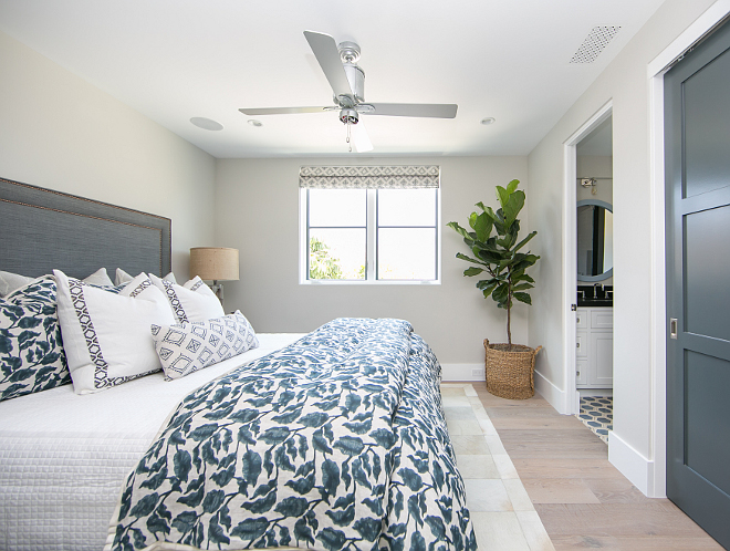 Guest Bedroom. On the second level you'll find a guest bedroom with en-suite bath. Wall color is Dunn Edwards DEC 774 Shady. Guest bedroom color palette. #GuestBedroom #colorpalette Patterson Custom Homes
