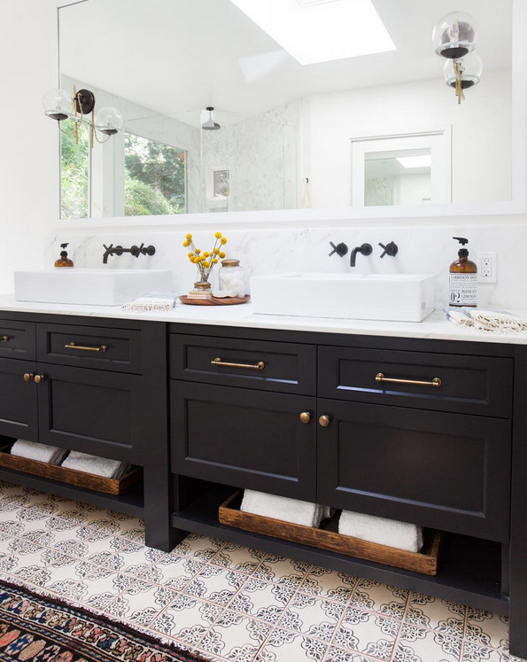 Bathroom Freestanding Double Vanity. Bathroom with freestanding navy double sink vanity topped with white counter and wall mounted faucets. Bathroom freestanding vanity and Cement tiles flooring. #Bathroom #FreestandingVanity #Doublevanity #cementtiles #bathroomcementtiles #wallmountedfaucet Amber Interiors