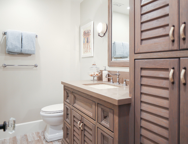 White oak cabinets add a coastal feel to this bathroom. Patterson Custom Homes. Interiors by Trish Steele, Churchill Design.