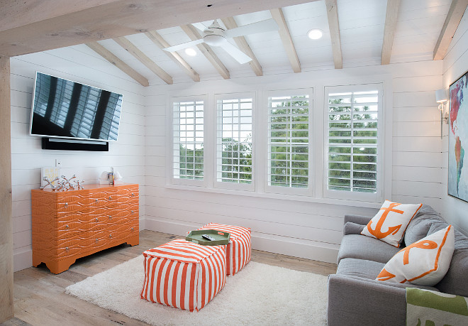 Playroom. Kids TV room play room. Kids playroom tv room furniture and decor. Playroom – Chest – Guildmaster, sofa – Duralee, Poufs and pillows – Anne Selke, Map- Leftbank Art, Rug - Loloi Interiors by Courtney Dickey of TS Adams Studio.