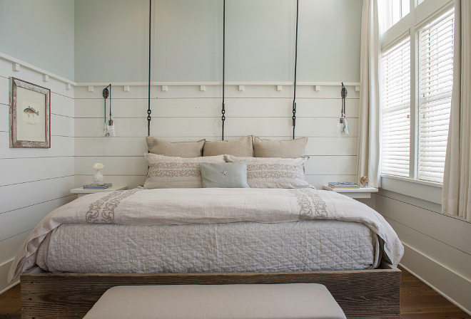 "This custom bed features reclaimed wood base and wrought iron ""headboard"". #custombed #bed #reclaimedwoodbed #wroughtironbed Interiors by Courtney Dickey and T.S. Adams Studio."