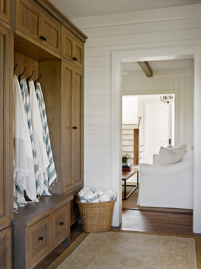 Reclaimed white oak cabinet. Just off the family room, this cozy mudroom features beautiful graywashed reclaimed white oak cabinets and shiplap walls. Rug is vintage. #Mudroom #graywashedcabinet #graywashedreclaimedwhiteoak #graywashedreclaimedwhiteoakcabinet #reclaimedwhiteoakcabinet T.S. Adams Studio, Architects