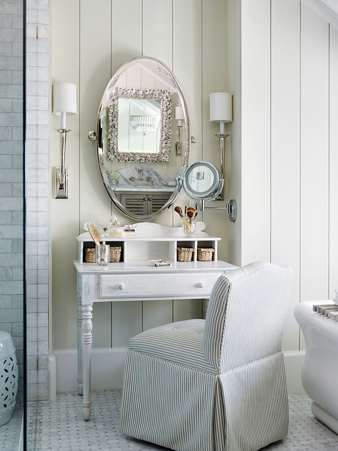 Vanity Table. Vanity. An antique make-up vanity was added to this bathroom to create a special place by the freestanding tub. A slipcovered chair, wall sconces and an oval mirror finishes the look.