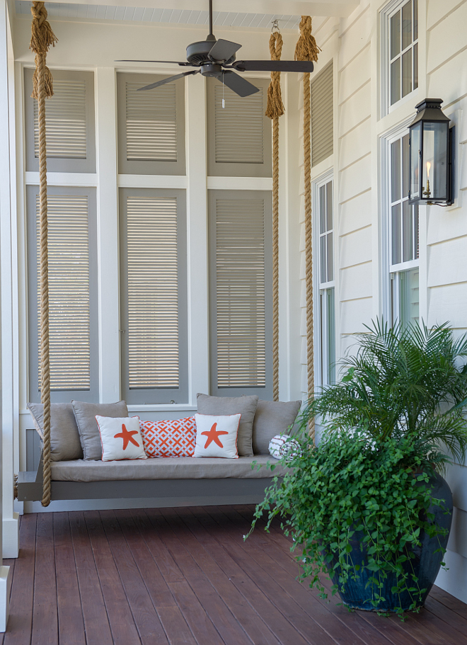 Bed swing paint color Benjamin Moore Briarwood. Porch with bed swing. Gray swing painted in Benjamin Moore Briarwood. #BenjaminMooreBriarwood Interiors by Courtney Dickey and T.S. Adams Studio.