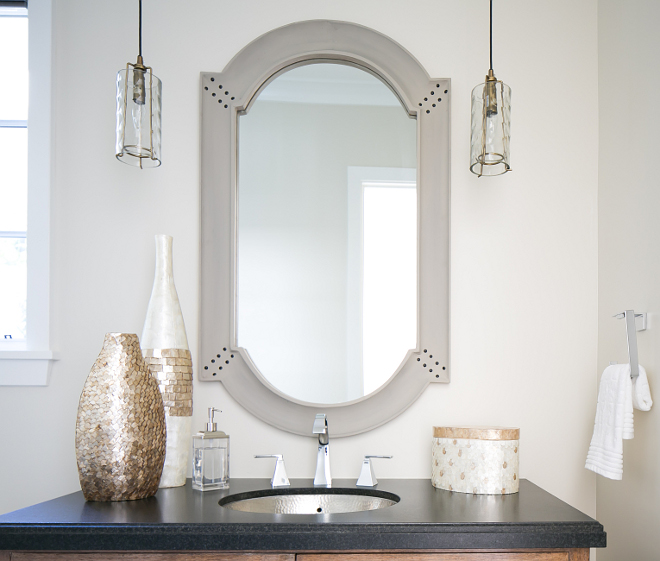 Powder room. Lighting is Arteriors Ice Small Pendants DK42050 - $420 each.  Countertop is Absolute Black Granite. #powderroom #granite #blackgranite #lighting  Patterson Custom Homes. Brandon Architects, Inc.